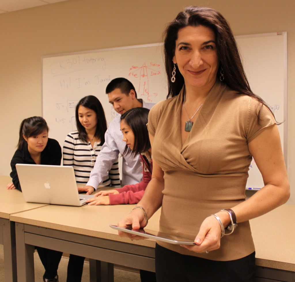 Professor Barba, with students in class. She has adopted flipped classroom approaches to teaching, with video being used to deliver content, and active-learning in the classroom. Photo by Saana McDaniel (2012).
