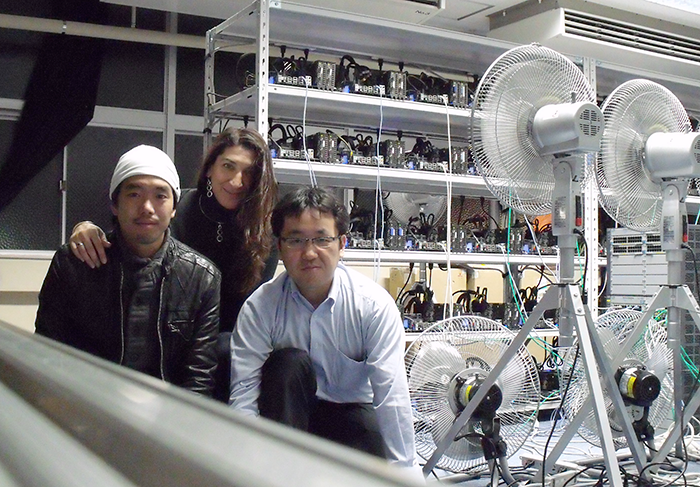 Rio Yokota, L Barba and Tsuyoshi Hamada, posing next to Degima, the do-it-yourself GPU cluster in Nagasaki, 2010
