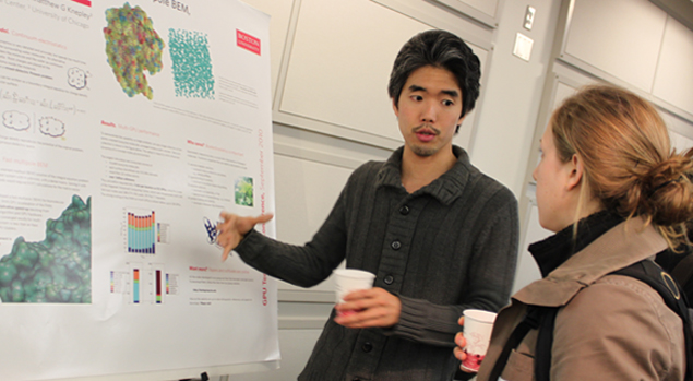 Rio Yokota explaining a poster at the ME@BU Open House (2011)