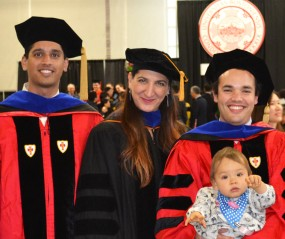 Happy graduation! Prof. Barba flanked by her students Anush Krishnan and Christopher Cooper (holding his baby daughter)